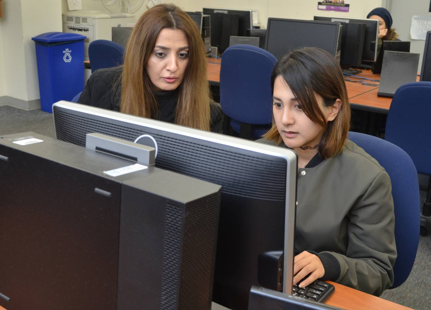 Teacher with a student at a computer