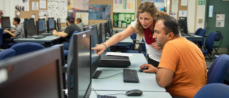 Computer Lab - Tutor helping student