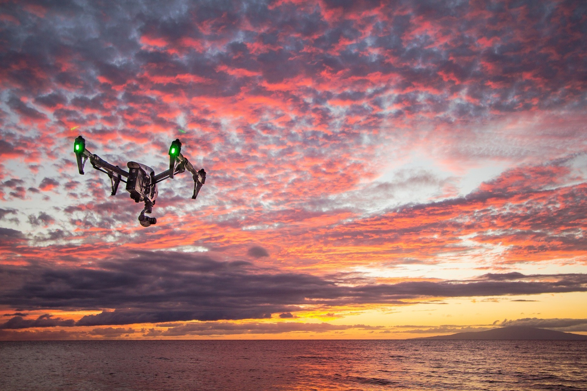 Drone at sunset under clouded skies
