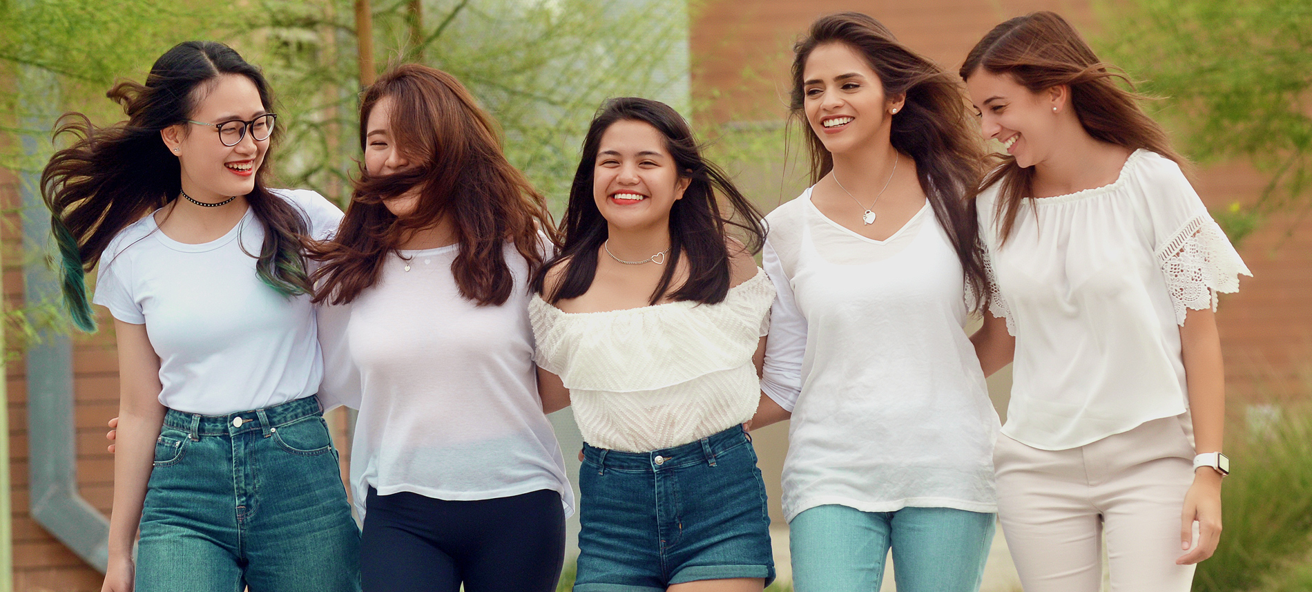 five international students laughing